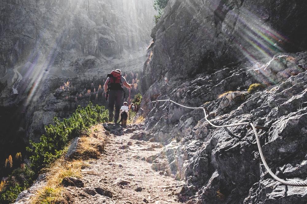 man walking on mountain side